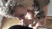 curly-haired blonde sucks cock