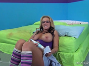 Big-titted mom in glasses and long socks squirting while stimulating her pierced clit with a wire vibro