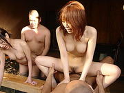Two horny Japanese dudes having fun with two chicks in the sauna pool