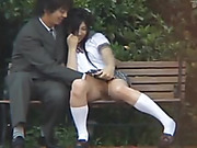 Japanese chick in a school uniform getting her pussy rubbed in the park by her BF