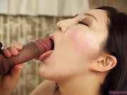 Seductive Japanese babe caressing man's meat with her soft tongue