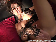 Indulging babe exposes her hot round boobs and sweet pussy while lying on a black sofa wearing her black leather corset before rubbing jizz on her feet.