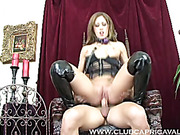 Pretty hottie in a black leather corset and high boots gets her ass drilled by a metal toy then gets fucked on a wooden chair with a ball gag in her mouth.