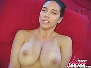 Luscious chick displays her big boobs as she lays down naked on a red couch while jacking off a big hard dick before pumping it with her feet.