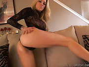 Sensual blonde in black lace top shows ass and tits and works pussy with fingers