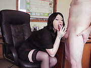 Lady boss in black stockings sucks and strokes a subordinates cock at the office.