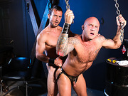 Dominant dude driving some discipline to a cub in the dungeon.