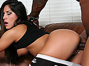 First-class madam in a black dress takes a black cock on the couch.