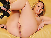 Lovely belle in a black top gets tapped on a tan couch.