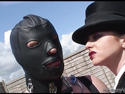 Brunette mistress in a topper forces her masked slave drive her on a cart before group banging