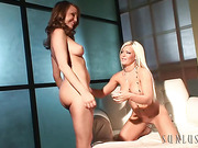 Dark-haired busty cougar in a black dress gets horny when shooting on cam her blonde BFF posing and lezzing her