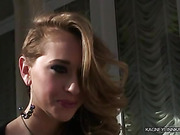 Cute seductress in a nice dress with big earrings talking about her sexual preferences