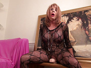 Horny granny in a black lace catsuit pounding her old snatch with a huge dildo