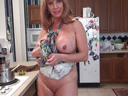 Hot oil masturbation on the floor from a dirty granny in an apron on her naked body