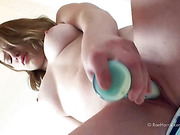 Gorgeous nude lady gets her juicy pussy pounded hardy using a green toy till she gets wet.