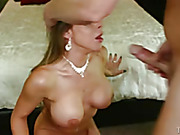 Busty bitch in a necklace sucking a long dong tearfully