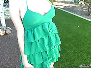 Four-eyed brunette chick with huge boobies in green dress fingering her muff from behind