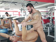 Two sweaty hunks enjoy hard gay fuck after a work out in the gym