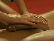 Long-haired brunette gives a skillful oil massage with her body before sensual cock massage