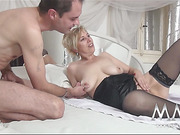 Short-haired blonde mature in nylons with big juggs  hanging out with two younger lads