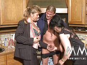 Busty brunette BBW in a black dress and nylons and her assistant enjoy threesome in the kitchen