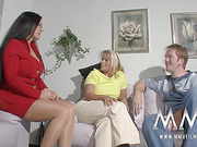 Busty blonde mom gives final handjob in dirty threesome with brunette BBW in a red suit