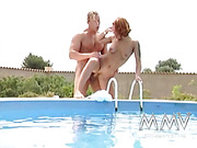 Busty red life guard with big juggs gets banged by ponytailed stallion outdoors