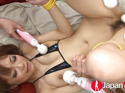 Hot Japanese babe gets tied upside down on a red couch with a yellow rope wearing her black and blue bikini bra while getting her hot body rubbed with a bunch of vibrators then she gets her hairy pussy sprayed with oil and massaged with all the vibrators