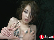 Sexy Japanese hottie wearing cobra skin designed bikini lets a guy squeeze her boobs and play with her pussy then she lets him take off her panty and finger it from behind before he rubs a big pink and white vibrator on her tits and crack making her spray