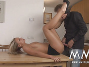 Arousing bonde chick in a black skirt gets drilled on the kitchen table