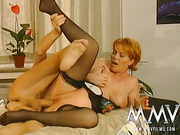 Big-titted redhead in a sexy lingerie swallows cum after getting her mature cunt drilled well