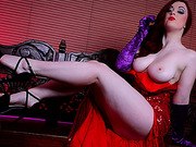 Stacked red goddess in a luxurious dress gives a deep throat blowjob