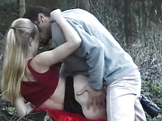 Catch a couple fucking in the woods with the girl's black skirt hiked up.