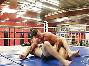 Gay wrestler wearing back and blue spandex is having a match in the ring with a hunk fighter in violet and green spandex before he wanks his opponent's dick and sucks it then they get naked and rub oil on their big bodies before he eats his schlong then l