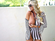 Wicked belle in a mesh dress with vertical black and white stripes gets stuffed in bed.