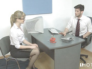Blonde office whore wears glasses while being fucked in the workplace.