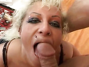 Cougar's mouth is cum covered after she has lifted her legs for a rigorous screw.
