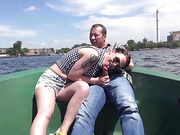 Maiden loses her shorts and black and white top to ride dick on a small boat.