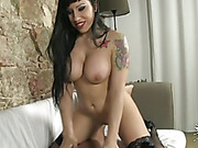 Busty inked brunette vixen in black stockings adores riding cocks