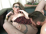 Curly blondie in sunglasses and fishnet pantyhose gets her twat licked before hard drilling