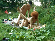 Spritely ginger and her blonde gal pal take on a bloke in a grassy area.