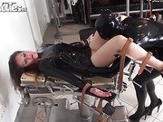 Latex-clad lover fingers and licks her girlfriend before fucking her with a sex toy.