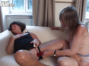 Chubby, mature lesbians with real tits play with a red sex toy.