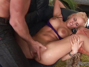 Short-haired blonde gets her pussy drilled on a black couch