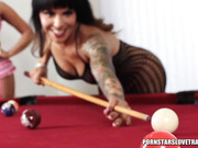 Foxy babe in pink lingerie plays pool with a tattooed shemale in black fishnet before she lets her stab a cue stick in her mouth then they make out before they share and sucks a big black dildo then lets her shove it deep inside asshole in different posit