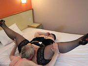 Loose shiela in black lingerie getting some cunnilingus in bed.