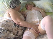 Welcoming old harlots getting on with some lesbian foreplay on floral sheets.