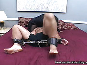 BBW in black lingerie and heels uses her thick assets to hamper her man's breathing.