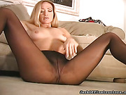 Blonde's big strap-on is on display as she encourages your self-pleasure.
