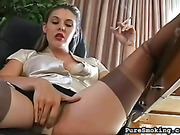 Black ashtray catches ash from a lady's cigarette while she rubs her panty-covered pussy.